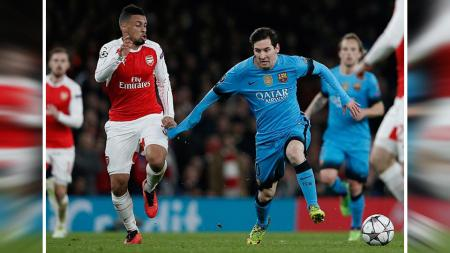Lionel Messi saat melawan Arsenal di Emirates Stadium. - INDOSPORT