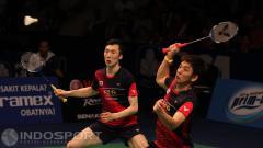 Indosport - Pemain bulutangkis asal Korea Selatan, Lee Yong-dae dan Yoo Yeon-seong.