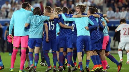 Para pemain Kroasia merayakan kemenangan. - INDOSPORT