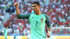 Indosport - Bintang timnas Portugal, Cristiano Ronaldo saat melawan Hungaria.