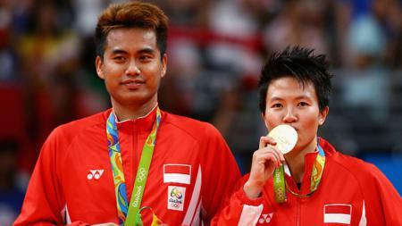 Tontowi Ahmad/Liliyana Natsir saat meraih emas di Olimpiade Rio 2016. - INDOSPORT