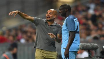 Pep Guardiola (kiri) dan Yaya Toure.