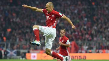 Arjen Robben merayakan golnya saat berseragam Bayern Munchen.