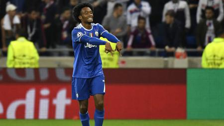 Juan Cuadrado selebrasi setelah mencetak gol ke gawang Lyon pada menit ke-76 - INDOSPORT