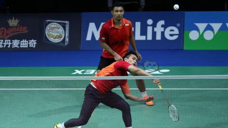 Pasangan Mohammad Ahsan/Berry Angriawan melaju ke babak perempatfinal French Open 2016. - INDOSPORT