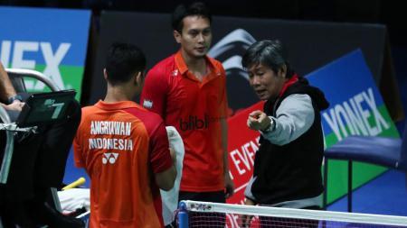 Pelatih ganda putra PBSI Herry IP mengungkapkan dua hal yang menjadi penyebab pasangan Mohammad Ahsan/Hendra Setiawan kalah di final BWF World Tour Finals 2020. - INDOSPORT