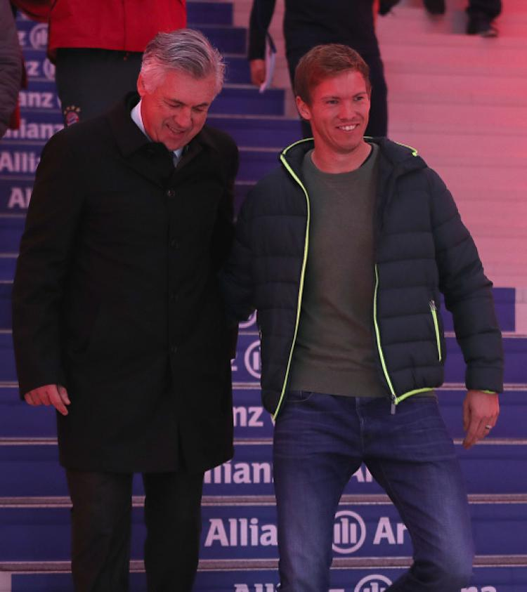 Pelatih Bayern Munchen, Carlo Ancelotti (kiri) dan Julian Nagelsmann, pelatih Hoffenheim. Copyright: Internet
