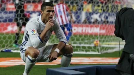 Selebrasi Cristiano Ronaldo usai mencetak gol ke gawang Atletico Madrid. - INDOSPORT