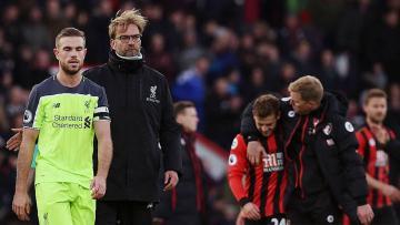 Jurgen Klopp dan Jordan Henderson usai laga melawan Bournemouth (04/12/16).