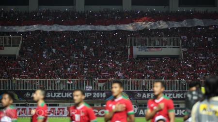 Koreografi dari suporter Tim Nasional (Timnas) Indonesia. - INDOSPORT