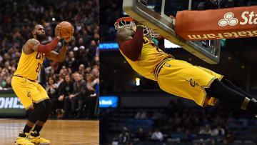 LeBron James melakukan aksi slam dunk.