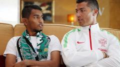 Indosport - Bintang Real Madrid, Cristiano Ronaldo dan anak angkatnya Martunis.