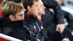 Indosport - Pelatih Liverpool, Jurgen Klopp, merasa kecewa dengan kekalahan yang diderita timnya dari Swansea City.