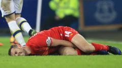 Indosport - Jordan Henderson saat mengalami cedera.