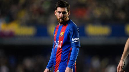 Ekspresi Lionel Messi ketika melawan Villarreal dalam lanjutan La Liga Spanyol. - INDOSPORT