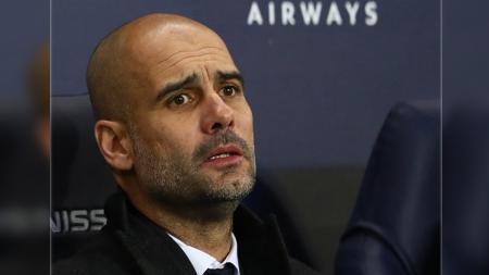 Pelatih sepak bola Manchester City, Pep Guardiola, menebar ancaman ke Liverpool meskipun timnya menderita kekalahan 1-3 di Anfield pada laga Liga Inggris. - INDOSPORT