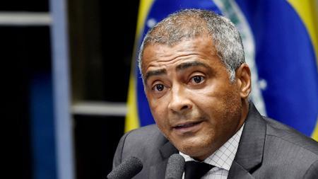 Mantan pemain Timnas Brasil, Romario. - INDOSPORT