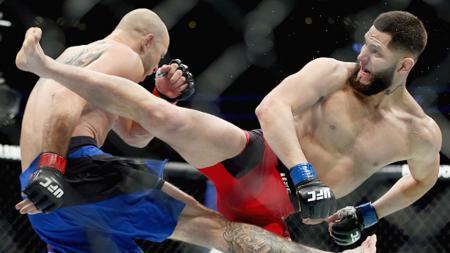 Petarung Amerika Serikat, Jorge Masvidal (kanan), resmi ditunjuk untuk menjadi lawan Kamaru Usman di ajang UFC 251 yang akan digelar di Fight Island 12 Juli nanti. - INDOSPORT