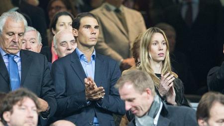 Rafael Nadal bersama sang istri menyaksikan laga Real Madrid vs Napoli. - INDOSPORT