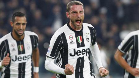 Aksi Claudio Marchisio usai mencetak gol pertama Juventus ke gawang Palermo. - INDOSPORT