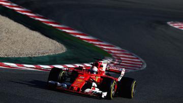 Sebastian Vettel ketika sedang menggeber mobil Ferrari di Barcelona.