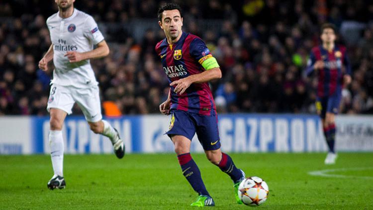 Xavi Hernandez saat masoh bermain bagi Barcelona. Copyright: Albert Llop/Anadolu Agency/Getty Images