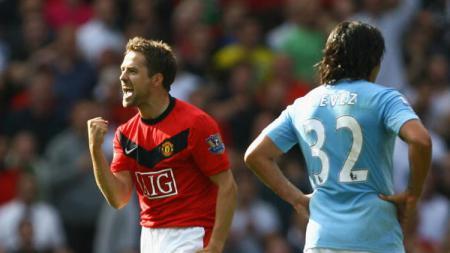 Owen saat masih aktif bermain di Manchester United. - INDOSPORT