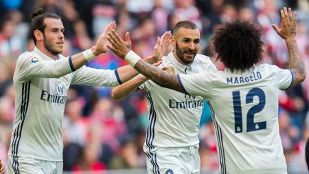 Karim Benzema, Marcelo, dan Gareth Bale saat merayakan gol. - INDOSPORT