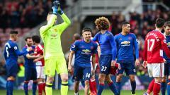 Indosport - Para pemain Manchester United melakukan selebrasi setelah pertandingan berakhir.