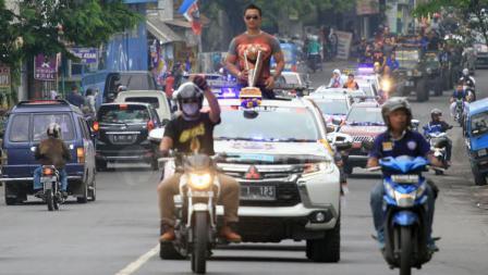 Konvoi di jalan lintas selatan Kabupaten Malang, tampak berjalan dengan tertib.