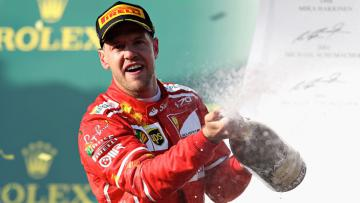 Pembalap Ferrari, Sebastian Vettel merayakan kemenangan di GP Australia.
