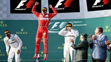 Pembalap Ferrari, Sebastian Vettel merayakan keberhasilan meraih gelar juara GP Australia.