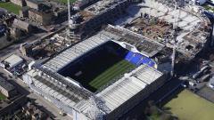Indosport - Proses proyek pembangunan stadion baru Tottenham Hotspur tampak dari atas.
