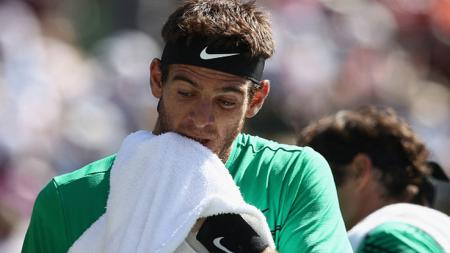 Ekspresi Juan Martin Del Potro usai dikalahkan Roger Federer. - INDOSPORT