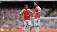 Indosport - Arsenal dikabarkan akan segera memulangkan Santi Cazorla (kiri) ke Liga Inggris pada bursa transfer musim panas mendatang.