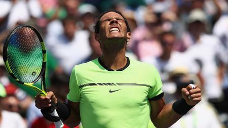 Petenis asal Spanyol, Rafael Nadal merayakan kemenangan di babak semifinal. - INDOSPORT