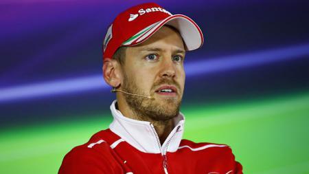 Menurut Ralf Schumacher, Sebastian Vettel tengah mengalami situasi yang kurang kondusif bersama Ferrari. Clive Mason/Getty Images. - INDOSPORT