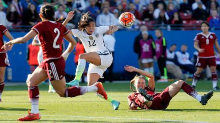 Christen Press (putih) saat bertanding di Piala Dunia Wanita 2015 bersama Timnas Wanita Amerika Serikat. - INDOSPORT