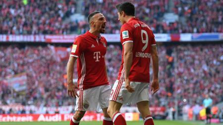 Robert Lewandowski pembobol gawang Dortmund di babak pertama. - INDOSPORT