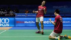 Indosport - Marcus Fernaldi Gideon/Kevin Sanjaya Sukamuljo selebrasi setelah kalahkan Fu Haifeng/Zheng Siwei.