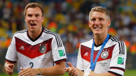 Kevin Grosskreutz dan Bastian Schweinsteiger saat juara Piala Dunia tahun 2014. - INDOSPORT