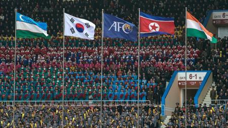 Deratan bendera kiri-kanan: Uzbekistan, Korea Selatan, Korea Utara dan India. - INDOSPORT
