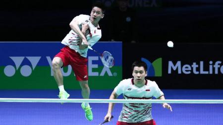 Pasangan ganda putra Indonesia, Kevin Sanjaya Sukamuljo/Marcus Fernaldi Gideon gagal melaju ke final Singapore Open. - INDOSPORT