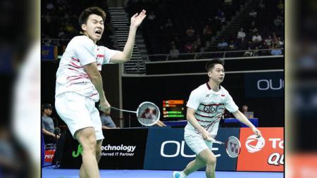 Aksi Kevin Sanjaya Sukamuljo/Marcus Fernaldi Gideon di Singapore Open Super Series 2017. - INDOSPORT