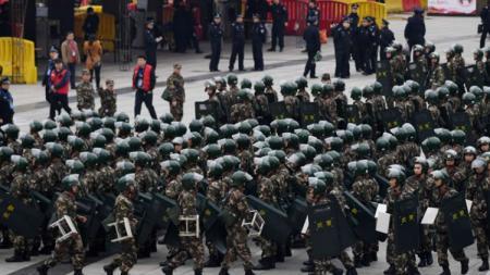 Penjagaan ketat mewarnai laga antara China melawan Korea Selatan. - INDOSPORT