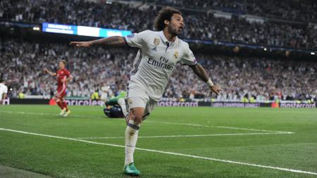 Marcelo harus pergi meninggalkan skuat Real Madrid hingga bulan Oktober. - INDOSPORT