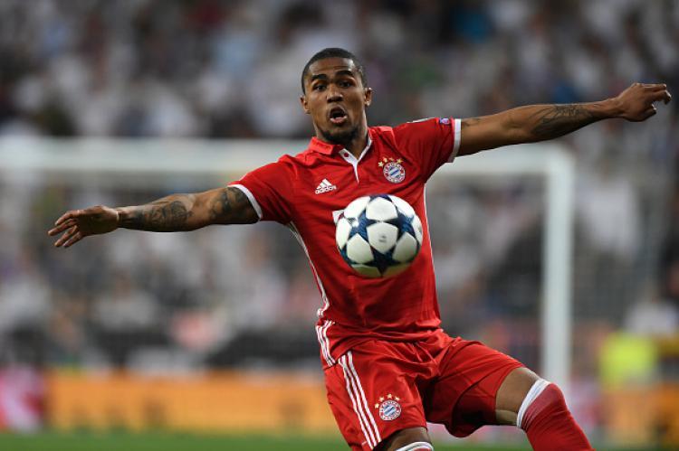 Douglas Costa, gelandang serang Bayern Munchen. Copyright: Etsuo Hara/Getty Images