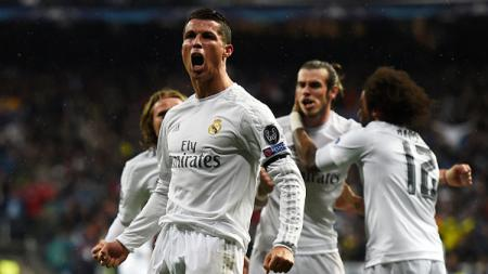 Ronaldo melakukan selebrasi usai cetak gol ke-2 ke gawang VfL Wolfsburg. - INDOSPORT