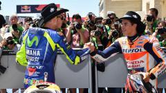 Indosport - Valentino Rossi dan Marc Marquez.