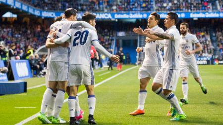 Para pemain Madrid merayakan gol cepat yang dicetak oleh Morata. - INDOSPORT